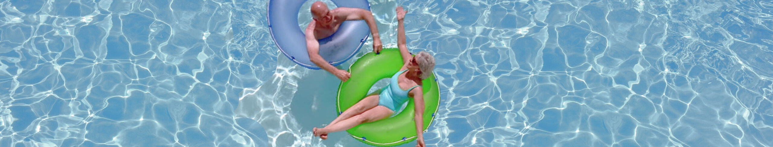 senior couple relaxing in a swimming pool